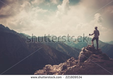 stock-photo-woman-hiker-on-a-top-of-a-mountain-221809534